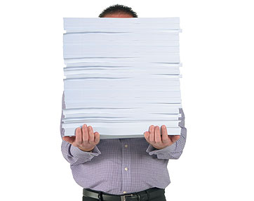 man-with-pile-of-paper1